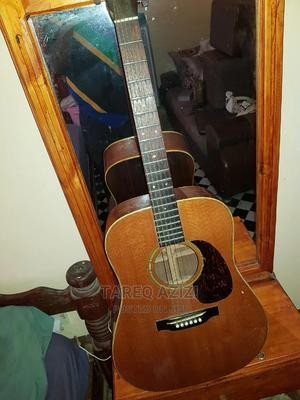 Accoustic Guitar Capo And Leather Bag | Musical Instruments & Gear for sale in Dar es Salaam, Kinondoni